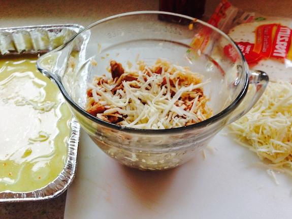 add enchilada sauce to bottom of pan