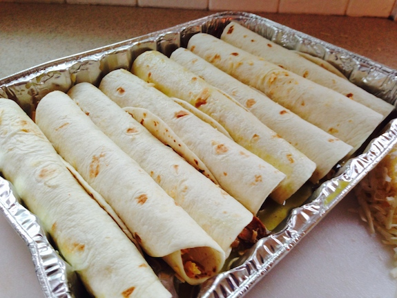 put rolled tortillas in pan