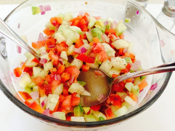 Mix fresh ingredients for Summer Shrimp Salsa Wraps