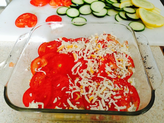 add tomato layer and more cheese