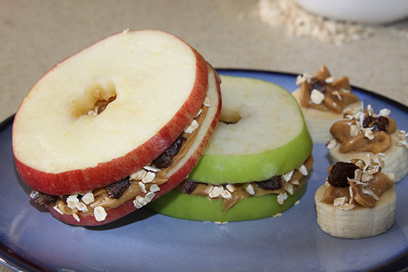 Apple & Banana Slices with peanut butter, oats and raisins