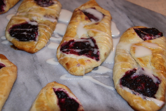 Add icing onto finished Blackberry Pastries