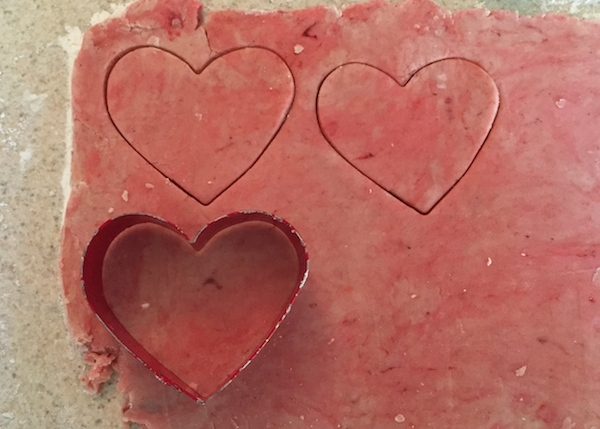 cut out dough hearts for pops