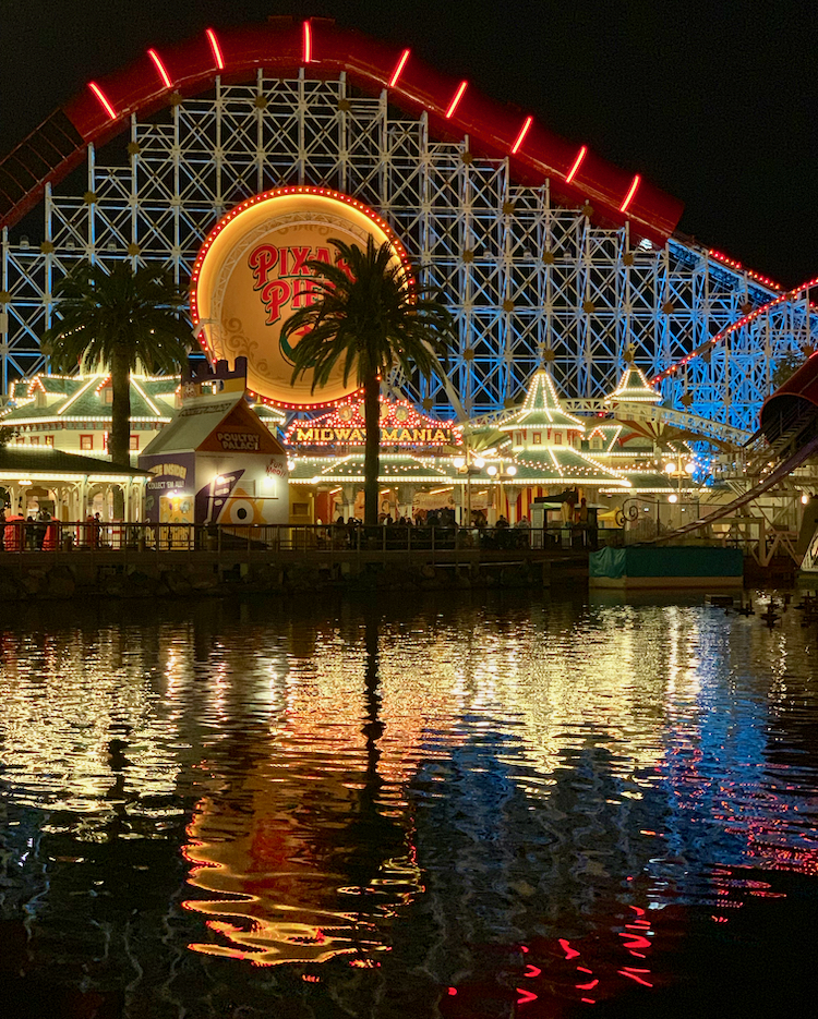 image showing the pixar pier lit up at night